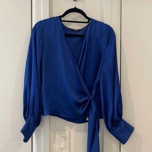 Blue tie wrap blouse with button details